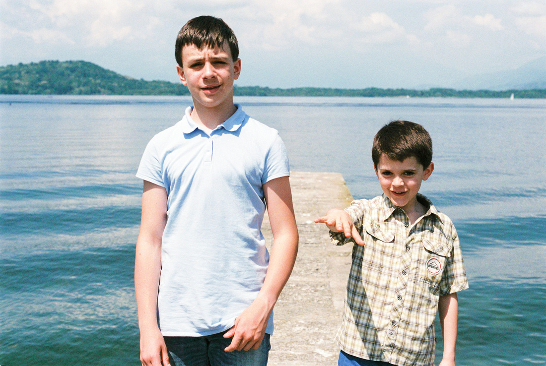 portrait of brothers children by the lake